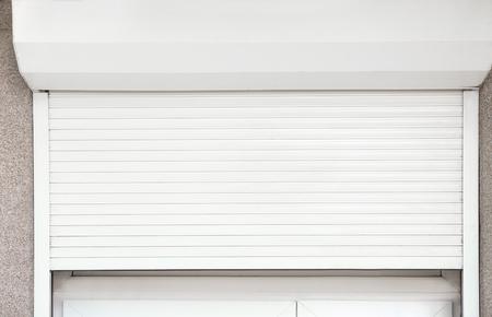 Photo pour Window with half-closed roller shutter, closeup - image libre de droit