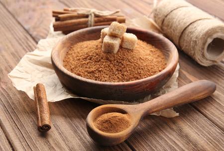 Foto de Composition with cinnamon sugar and powder on wooden background - Imagen libre de derechos