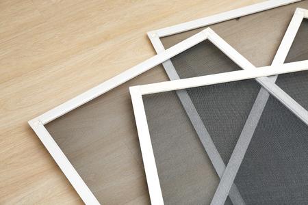Foto de Mosquito window screens on floor - Imagen libre de derechos