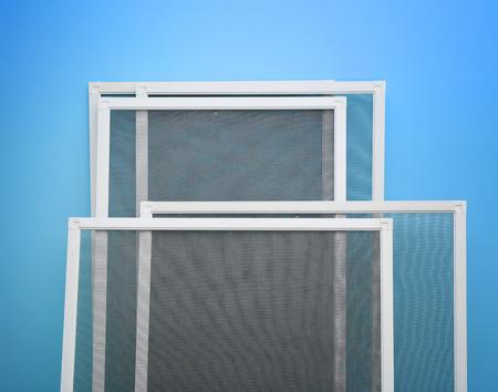 Foto de Mosquito window screens on color background - Imagen libre de derechos