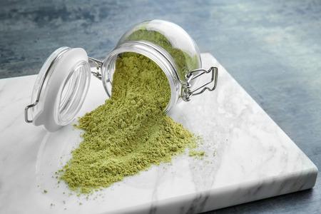 Photo pour Hemp protein powder and glass jar on board - image libre de droit