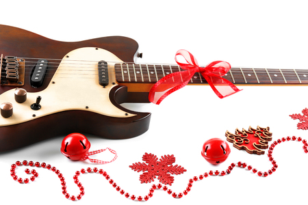 Photo for Christmas music concept. Guitar with decoration, isolated on white background - Royalty Free Image