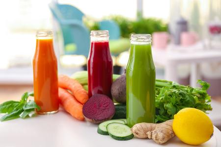 Foto für Bottles with various fresh vegetable juices on table - Lizenzfreies Bild