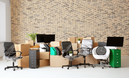 Photo pour Carton boxes with stuff in empty room. Office move concept - image libre de droit