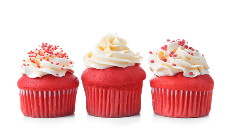 Foto de Delicious red velvet cupcakes on white background - Imagen libre de derechos