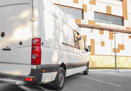 Photo pour White van parked on street - image libre de droit
