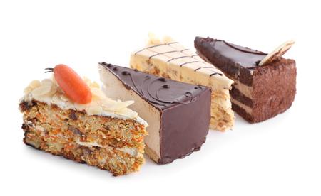 Photo pour Pieces of tasty cakes on white background - image libre de droit
