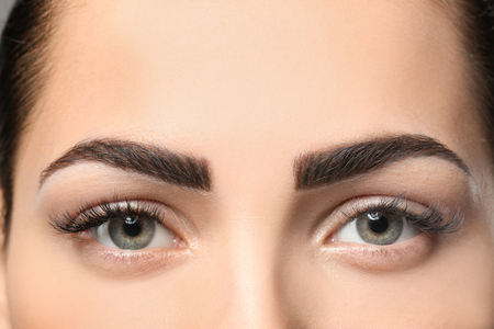Foto de Young woman with permanent eyebrows makeup, closeup - Imagen libre de derechos