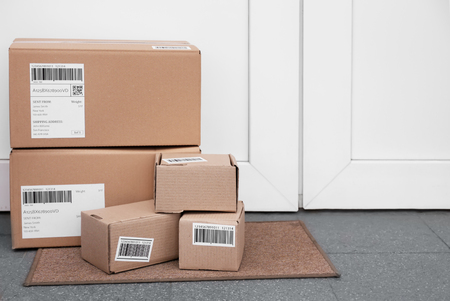 Photo for Delivered parcels on floor near front door - Royalty Free Image