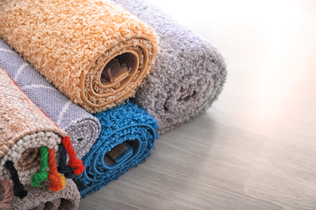 Photo pour Rolled colorful carpets on floor - image libre de droit