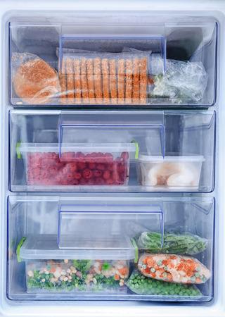 Foto de Different products in refrigerator freezer - Imagen libre de derechos
