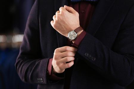 Foto de Young man in elegant suit on blurred background - Imagen libre de derechos