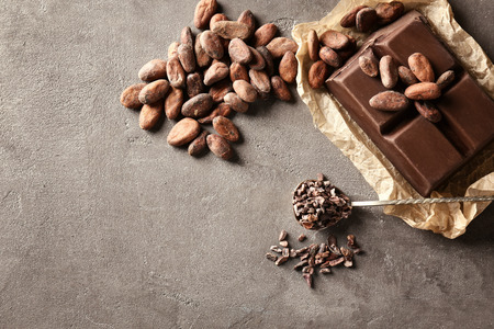Photo pour Composition with cocoa products on grey background - image libre de droit