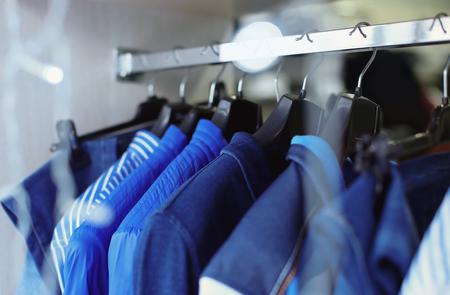 Foto de Rack with men's clothes in boutique - Imagen libre de derechos