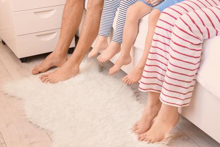 Photo pour Family sitting on bed at home - image libre de droit