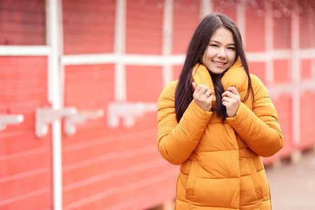Foto de Attractive young woman in warm clothes outdoors - Imagen libre de derechos