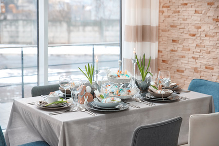 Photo for Beautiful Easter table setting with decorations - Royalty Free Image