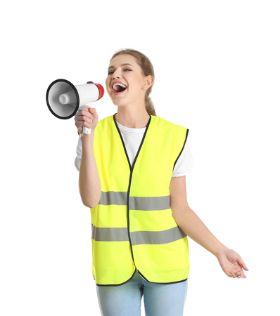 Foto per Young woman in reflective vest with megaphone on white background - Immagine Royalty Free
