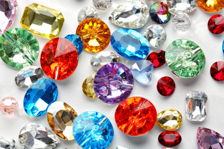 Foto de Colorful precious stones for jewellery on white background - Imagen libre de derechos
