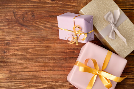 Photo for Gift boxes on wooden background, top view - Royalty Free Image