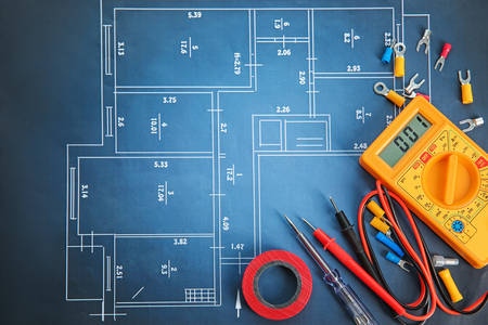 Photo for Flat lay composition with electrical tools on house plan - Royalty Free Image