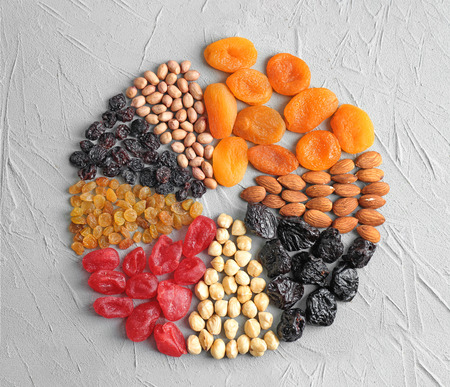 Photo pour Different kinds of nuts and dried fruits on table - image libre de droit
