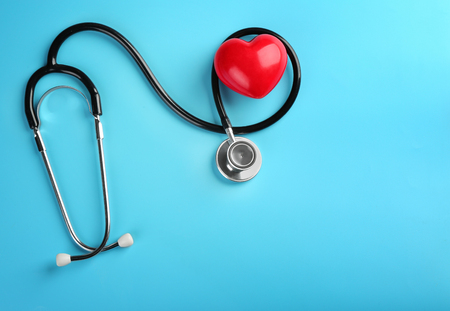 Photo for Stethoscope with small heart on color background - Royalty Free Image
