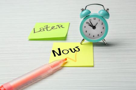 Photo pour Alarm clock and paper sheets for notes on table. Time management concept - image libre de droit