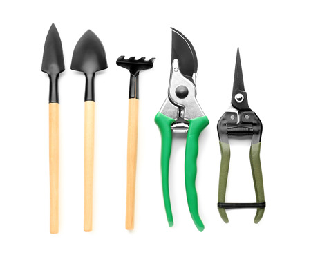 Foto de Gardening tools on white background - Imagen libre de derechos