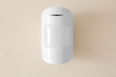 Foto de Modern motion sensor on wall indoors - Imagen libre de derechos