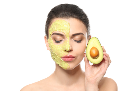 Photo pour Beautiful young woman with facial mask and fresh avocado on white background - image libre de droit