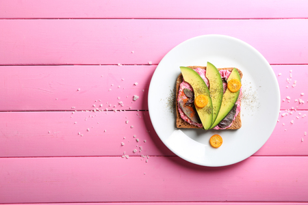 Photo for Delicious toast with avocado on plate - Royalty Free Image