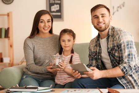 Foto de Happy family counting money indoors. Money savings concept - Imagen libre de derechos