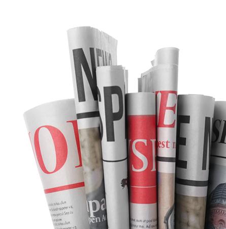 Photo pour Folded newspapers on white background - image libre de droit