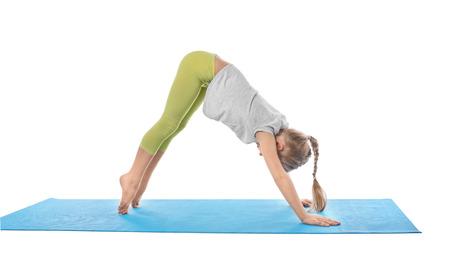 Photo pour Little girl practicing yoga on white background - image libre de droit