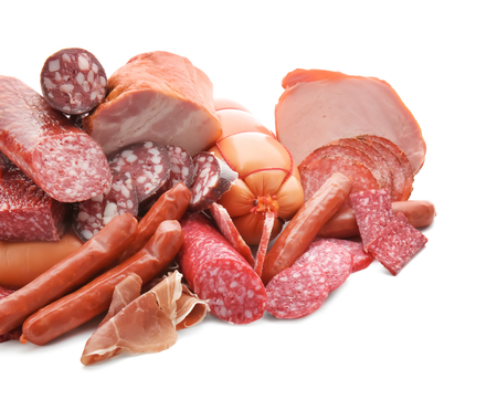 Foto de Assortment of delicious deli meats on white background - Imagen libre de derechos