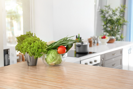 Photo pour Fresh vegetables on wooden table in kitchen - image libre de droit