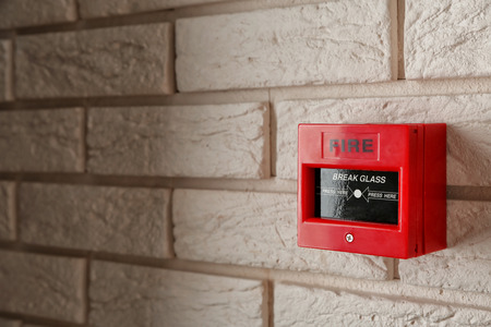 Photo pour Modern fire call point on brick wall indoors - image libre de droit