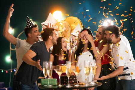 Foto de Young people at birthday party in club - Imagen libre de derechos
