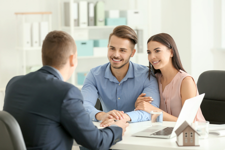 Photo pour Real estate agent working with clients in office - image libre de droit