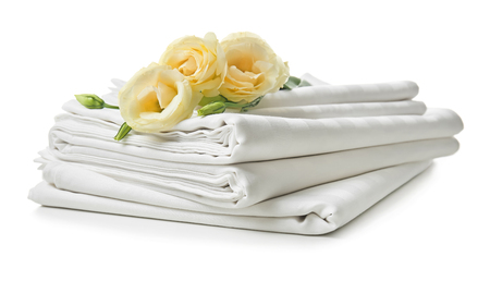 Photo pour Stack of clean bed sheets on white background - image libre de droit