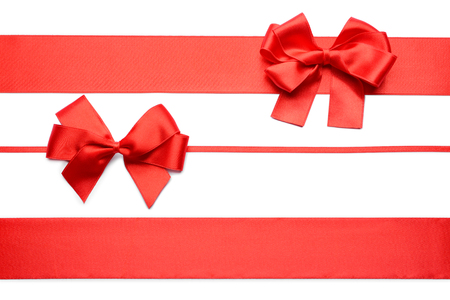Foto de Red ribbons with bows on white background - Imagen libre de derechos