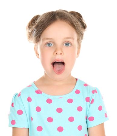Photo pour Cute little girl showing tongue on white background - image libre de droit