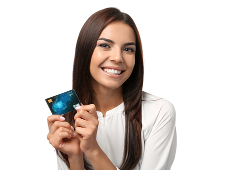Foto de Young woman with credit card on white background. Online shopping - Imagen libre de derechos