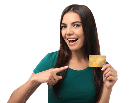 Photo for Young woman with credit card on white background. Online shopping - Royalty Free Image