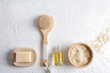 Bath products with brush on white textured backgroundの写真素材