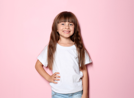 Little girl in t-shirt on color background