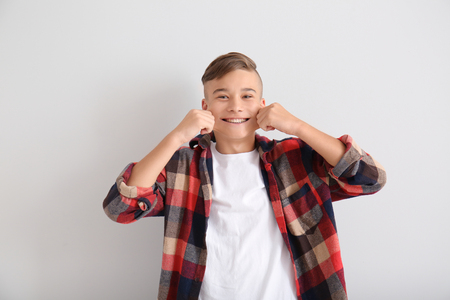 Foto per Funny teenage boy on white background - Immagine Royalty Free