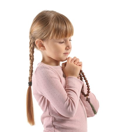 Photo for Little girl with beads praying on white background - Royalty Free Image