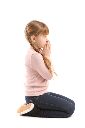 Photo for Little girl praying on white background - Royalty Free Image